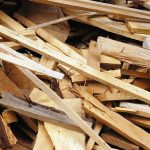Pile of wood scraps some with the nails in them